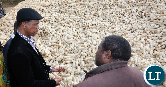 President Edgar Lungu chats with Mr Joseph Daka Maize Seed farmer of Mkushi farming Block during the Tours of Mkushi farms4076