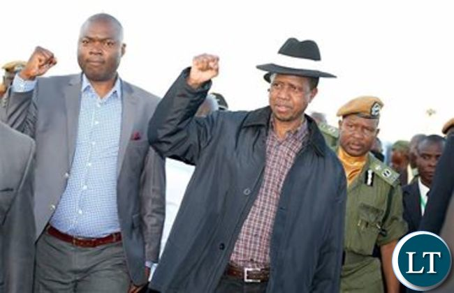 President Lungu with Copperbelt Minister Lusambo flashing the PF symbol