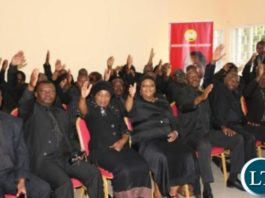 UPND MPs flashing the party symbol during a news briefing