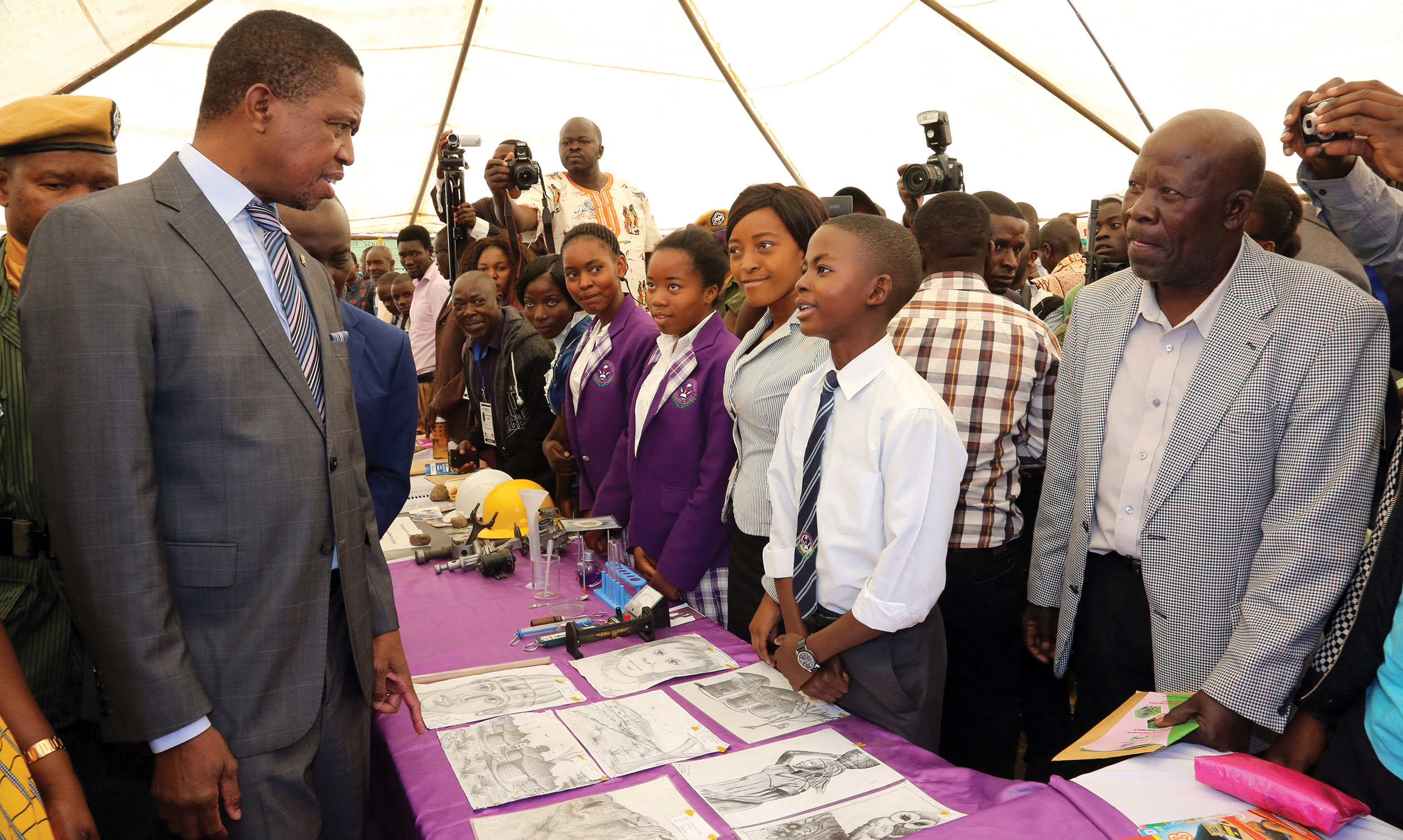 PRESIDENT Lungu talks to 13-year-old Cosmas Mulenga, an art student of Fordina Pandeni Secondary School, at the on-going Luapula Expo in Mansa yesterday. PICTURE: EDDIE MWANALEZA/STATE HOUSE