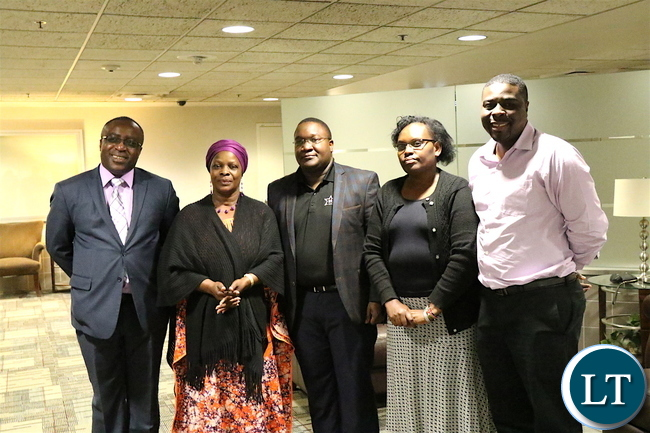 First Lady Esther Lungu poses for a photograph with Zambia's Charge' d'affaires in Washington D.C. Joseph Chilaizya and officials from the Starkey Hearing Foundation on arrival at Minneapolis St. Paul's Airport, Mi on Friday, July 14,2017 -Picture by Cosmas Chileshe