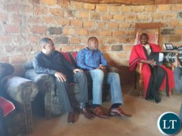 In a meeting with Chief Machiya at his palace, flanked by Mpongwe DC