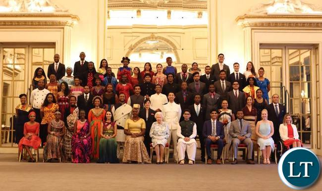 Natasha Salifyanji Kakoma sits next to Queen Elizabeth during a group photo