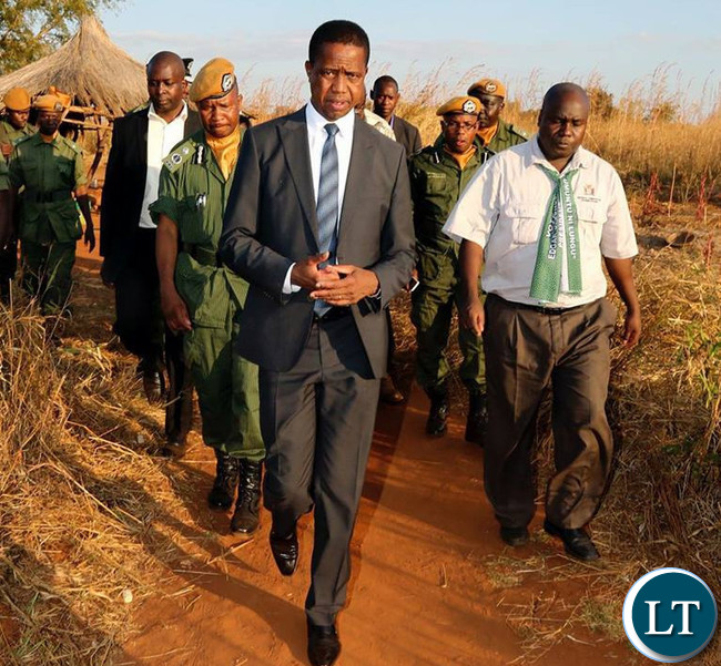President Edgar Chagwa Lungu (centre) accompanied by Southern Province Minisrer Dr. Edify Hamukale takes a walk in Dundumwezi on Tuesday,July 11,2017. PICTURE BY SALIM HENRY/STATE HOUSE ©2017