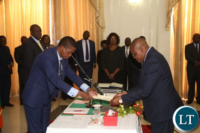 President Edgar Lungu receive the letter of Oath from Dr. Kennedy Malama during the swearing in Ceremony at State House