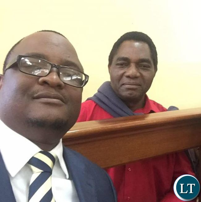 HH's lawyer Gilbert Phiri takes a selfie with his client during one of the court sessions