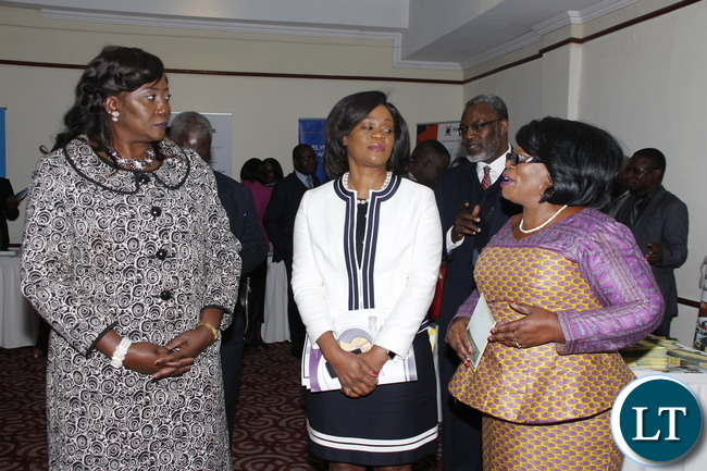 "Higher Education Minister Professor Nkandu Luo, Community Development and social welfare Minister Emerine and Baclays Bank PLC CEO Mizinga Mehlu interacting during the""Barclay's Bank scholarship"" launch at Lusaka Pamodzi Hotel on Tuesday, 1st August 2017."