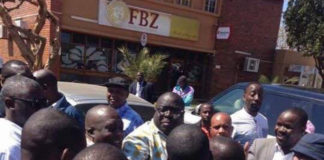 Mr Kambwili is mobbed by a cheering crowd in Monze town centre