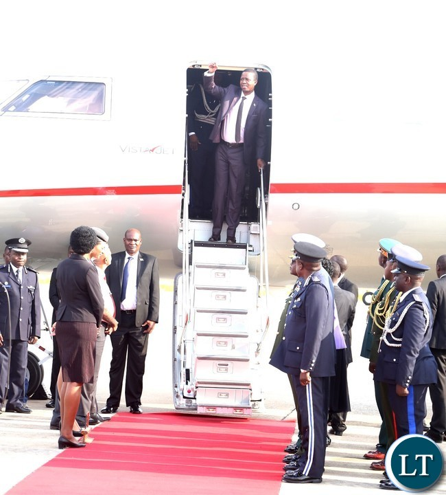 President Edgar Lungu wave the party symbol shortly after his arrival from United Nations (USA) Annual General Meeting Assembly at Kenneth Kaunda International Airport