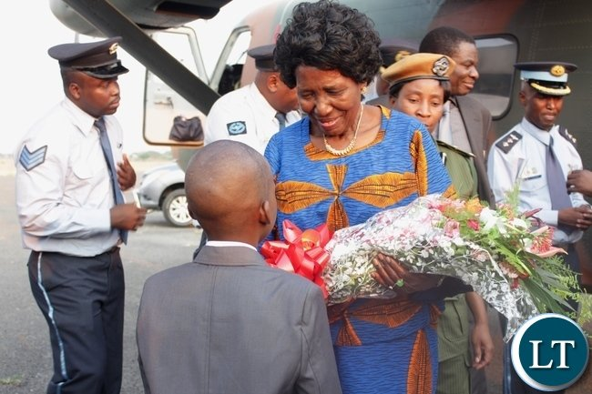 Vice President Inonge Wina (c) arrives at Mongu Airport yesterday for the Commissioning of the Connection of North-Western Province and Lukulu District to the Zesco National Grid.
