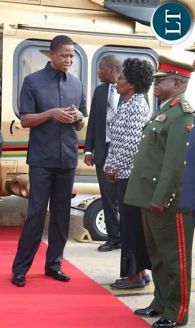 President Edgar Lungu confers Vice President Inonge Wina shortly before departure to Botswana whilst Zambia Army Commander Paul Mihova at Kenneth Kaunda International Airport