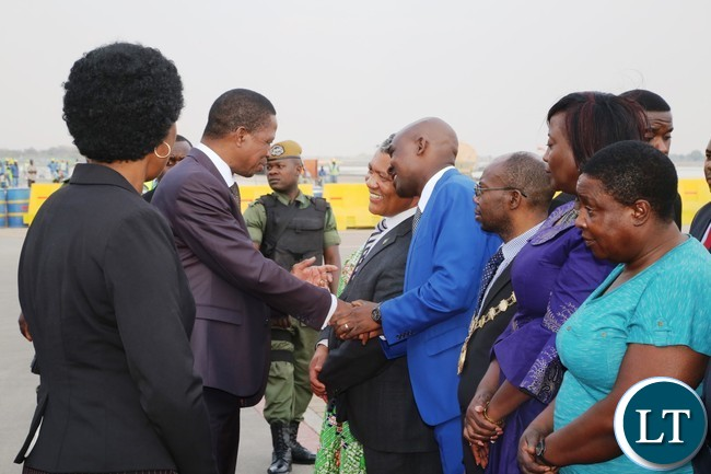 President Edgar Lungu speaking to Justice Minister Given Lubinda and Lusaka Province Minister Japhen Mwakalombe on his arrival from United Nations (USA) Annual General Meeting Assembly at Kenneth Kaunda International Airport