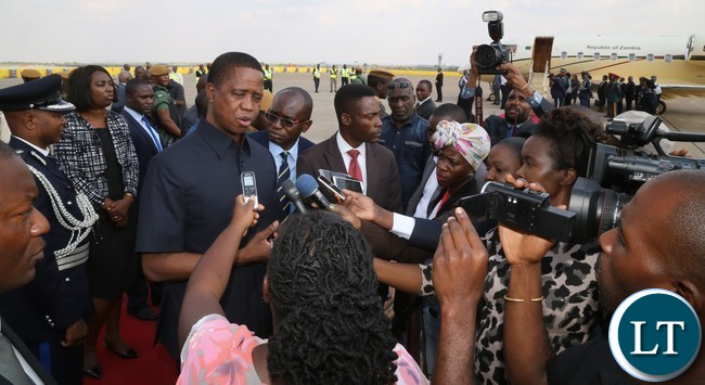 President Edgar Lungu speaking to journalists shortly before departure to Botswana whilst Zambia Army Commander Paul Mihova at Kenneth Kaunda International Airport