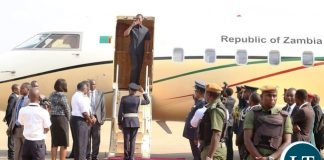 President Edgar Lungu wave with a flying kiss shortly before departure to Botswana whilst Zambia Army Commander Paul Mihova at Kenneth Kaunda International Airport