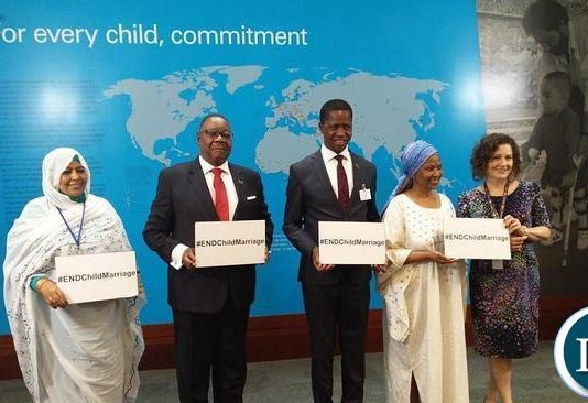 Presidents Mutharika (Malawi) and Edgar Lungu (Zambia) join anti-child marriage campaigners at an event.