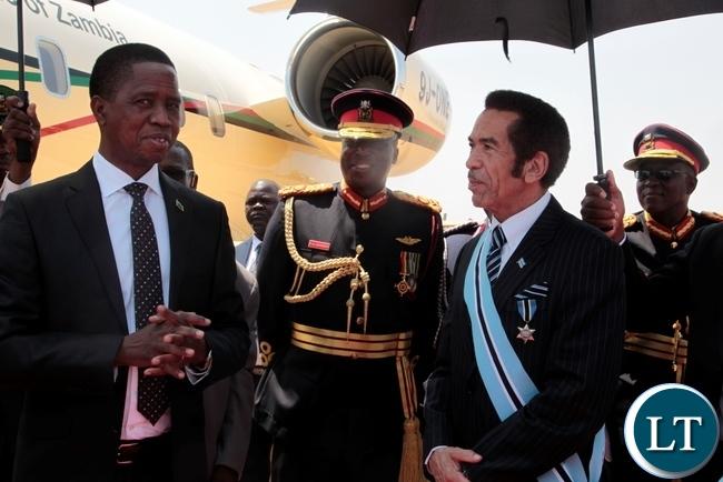 PRESIDENT Edgar Lungu in a conversation with President Seretse Khama Ian Khama shortly before departure for Lusaka at Sereste Khama International Airport