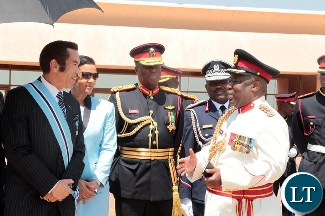 PRESIDENT Seretse Khama Ian Khama confers with Col .Chewe  after seeing off President Edgar Lungu at Sereste Khama International Airport