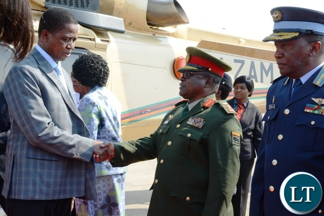 President Edgar Lungu greeting Service Chiefs at Kenneth Kaunda International Airport before departing for Angola.