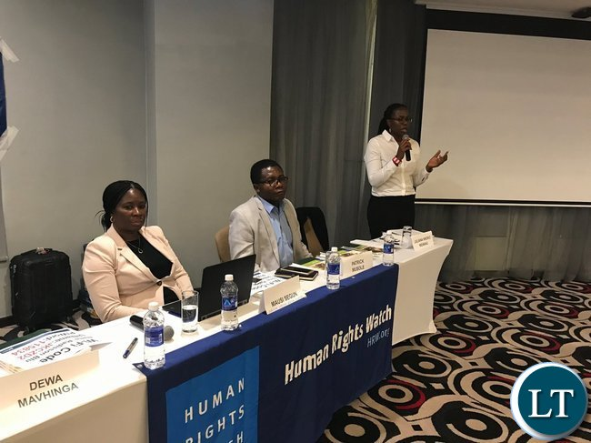 Human Rights Watch officials at the report launch in Lusaka on Wednesday