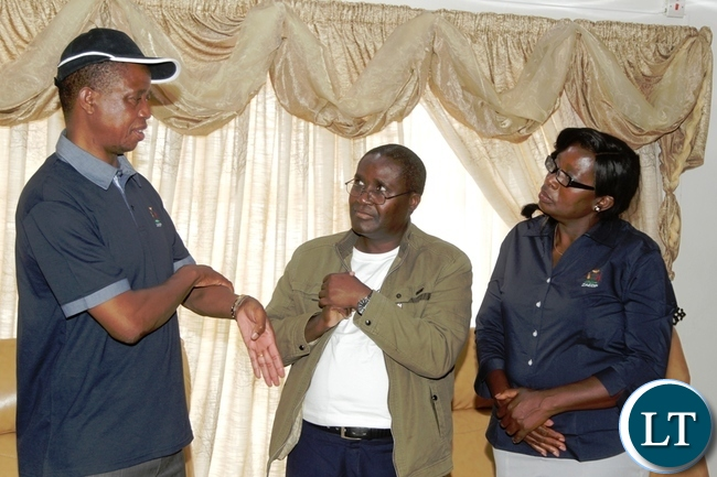 President Edgar Lungu talks to Dr Penias Tembo and his wife before the launch of Zambia Aquaculture Enterprise Development Project in Lilayi