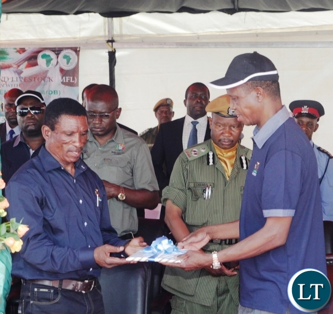 President Edgar Lungu receives a Project Document from fisheries and Livestock Minister Micheal Katambo during the launch of Zambia Aquaculture Enterprise Development Project in Lilayi