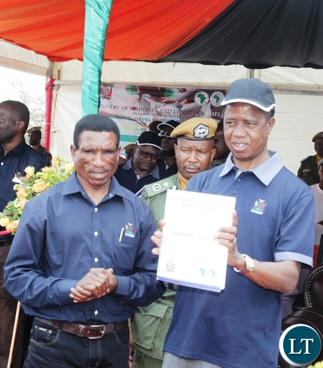 -President Edgar Lungu displays a Project Document during the launch of Zambia Aquaculture Enterprise Development Project in Lilayi