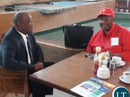 Mr Bwalya pictured with his lawyer Jack Mwiimbu at KKIA earlier today before flying off to Ndola for the court appearance.