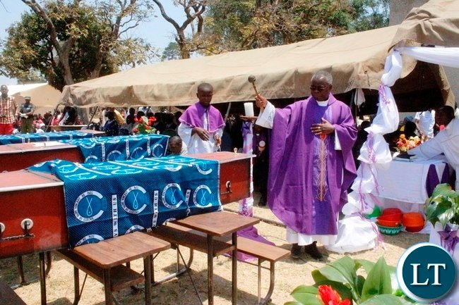 Vicar General Fr. Rodgers Fikwamo during mass for the burial of the 17 accident victims held at Mambwe Mission in Senga  district today. The 17 died when the Isuzu truck Reg No ACK 5871 which was carrying over 60 members of the Catholic church along the Mbala-Mpulungu road on saturday morning overturned after losing brakes. Several other people are still admitted to Mbala and Mpulungu hospitals with head inquires.-Picture by Mary Bwembya (ZANIS)