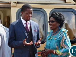 President Edgar Lungu confers with Inonge Wina shortly before his departure to Angola for Extraordinarily Trika summit