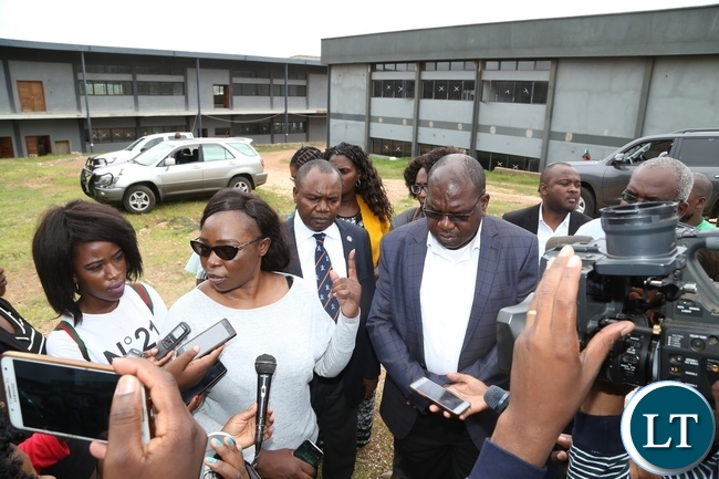 Levy Mwanawasa Hospital Director Physical planning Kakubelwa Mulalelo speaking to journalists whilst Minister of Health Chitalu Chilufya listens during the tour of expansion works Levy Mwanawasa Hospital