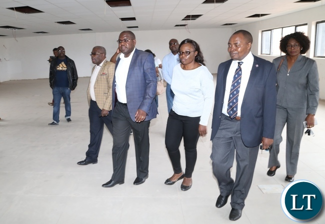 Minister of Health Chitalu Chilufya flanked by Permanent Secretary Cabinet office Stephen Mwansa (l) Levy Mwanawasa Hospital Medical Superintendent Dr. Lastone Chikoya (r) and (2nr) Levy Mwanawasa Hospital Director Physical planning Kakubelwa Mulalelo checking on the progress work at the lecturer theater Levy Mwanawasa Hospital