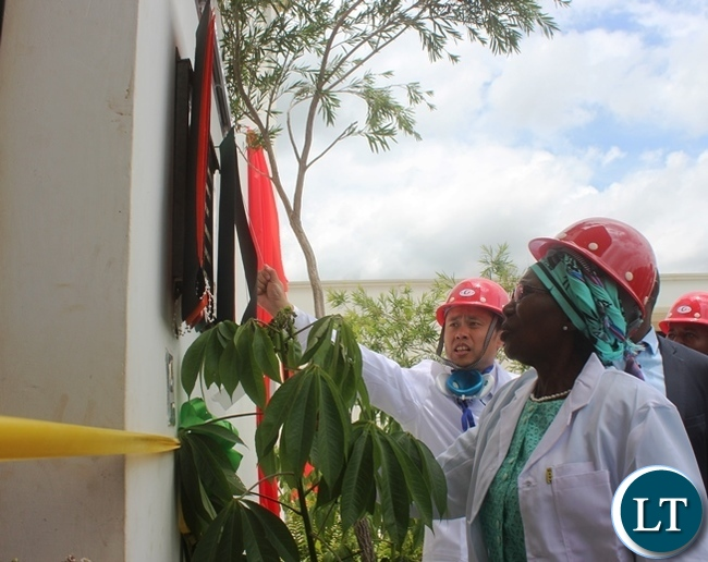 Vice president Inonge Wina unveils a plaque to officially open fertiliser plant in Kabwe
