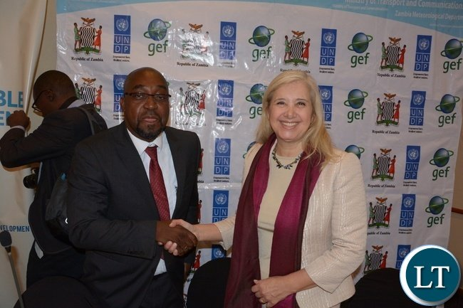 Minister of Transport and Communication Brian Mushimba shake hands with  Manager CIRDA-Programme UNDP Dr. Bonizella Biagini shortly after the official opening of UNDP regional workshop on Sustainability for Climate Information Services at Pamodzi Hote