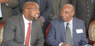Minister of Transport and Communication Brian Mushimba chats with World Meteorological Organisation (WMO) Representative for Eastern and Southern Africa based in Nairobi-Kenya Stephen Njoroge at Pamodzi Hotel y