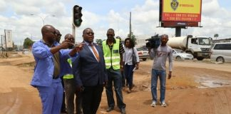 Special Assistant to the President for Project Implementations and Monitoring Andrew Chellah (l) with RDA member during the site visitation of the ongoing rehabilitation of Lumumba Road in Lusaka