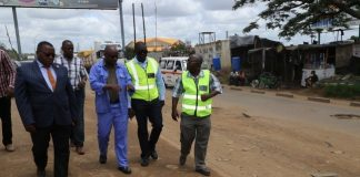 Special Assistant to the President for Project Implementations and Monitoring Andrew Chellah (c) with RDA member during the site visitation of the ongoing rehabilitation of Lumumba Road in Lusaka