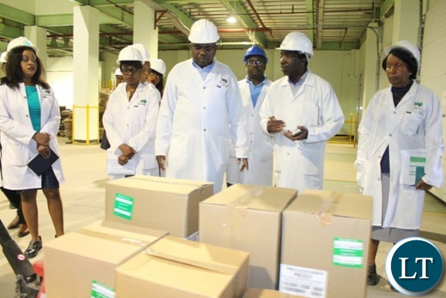 MEDICAL Stores Limited Warehouse Manager Ernest Sinyinda explains to Minister of Health Dr Chitalu Chilufya the availability of drugs at Medical Stores Limited in Lusaka yesterday during a conducted tour of the facility. Pictures By WEZI SIMBEYE/MINISTRY OF HEALTH