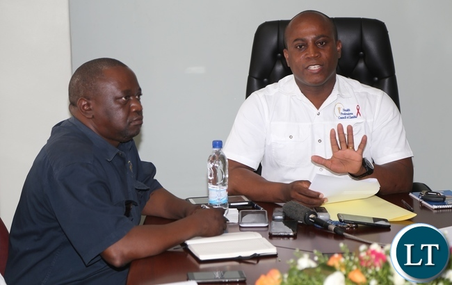 Health Professions Council of Zambia Chief Executive Officer Dr. Aaron Mujajati flanked by Health Professions Council of Zambia Chief operations Officer Kolala Mulenga (l) speaking to journalists during Health Professions Council of Zambia press briefing at there offices