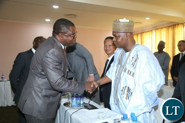 Minister of Foreign Affairs Joe Malanji greets High Commissioner of Nigeria to Zambia Mahammad Kabir Umar during the Diplomatic Corps and High Commissioners accredited to Zambia meet with the newly appointed Minister of Foreign Affairs at Mulungushi International Conference Centre
