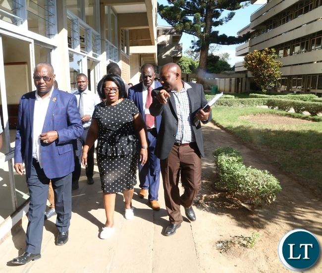 Minister of High Education Prof. Nkandu Luo (c) University of Zambia Vice Chancellor Prof. Luke Mumba (l) and University of Zambia Resident Engineer Ally Nyirenda during the tour and inspection of the hostels at UNZA