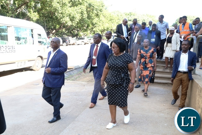 Minister of High Education Prof. Nkandu Luo (c) University of Zambia Vice Chancellor Prof. Luke Mumba (l) and the entourage during the tour and inspection of the hostels at UNZA