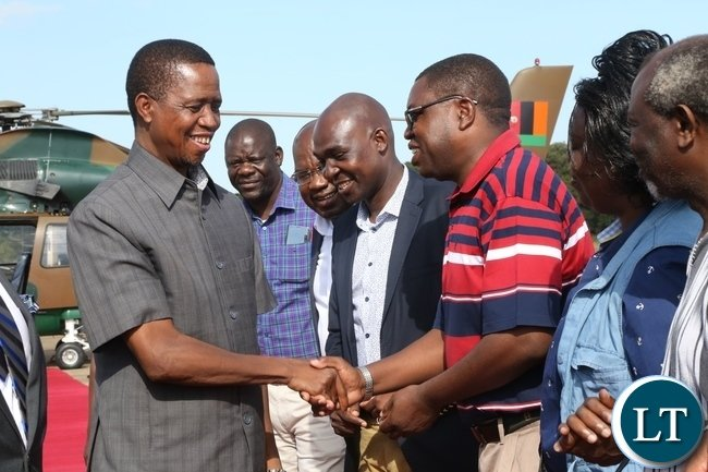 President Edgar Lungu shake hands confers with Minister of Foriegn Affairs Joe Malanji at ZAF Lusaka shortly before his departure to Muchinga Province for three days working visit