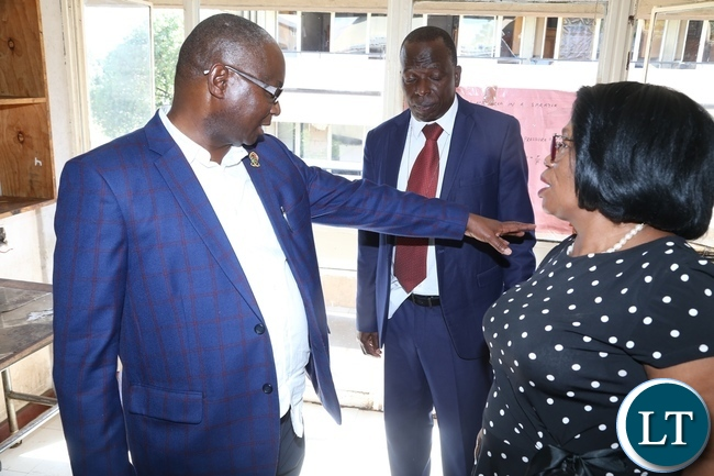 University of Zambia Vice Chancellor Prof. Luke Mumba confers with Minister of High Education Prof. Nkandu Luo during the tour to check on the clean up exercise in the hostels at UNZA