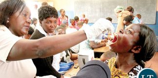 A WOMAN receiving a cholera vaccine in Lusaka's Chawama township