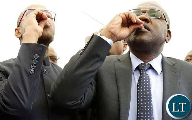 Dr Chilufya (R) and Deputy Secretary to the Cabinet Christopher Mvunga (L) taking the Cholera vaccine during the official launch of the vaccine programme.