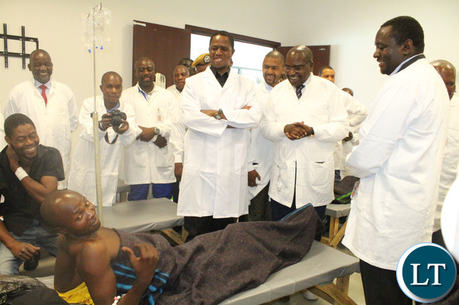 President Edgar Lungu with cabinet ministers share a light moment with a patient at Heroes Stadium Cholera Treatment Centre in Lusaka (Picture by Wezzy Simbeye/ Ministry of Health)