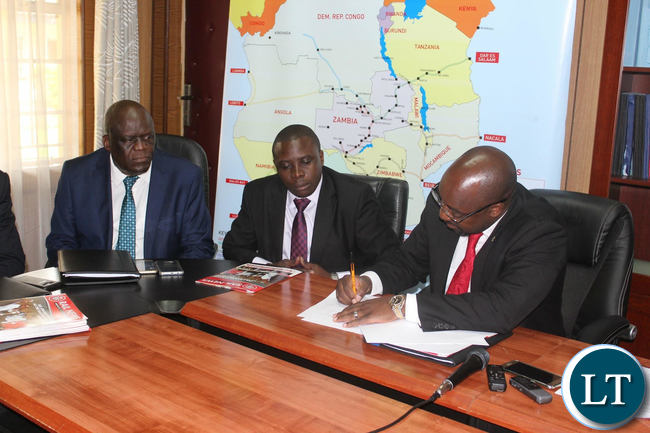 Transport and Communications Minister Brian Mushimba Signing the SI