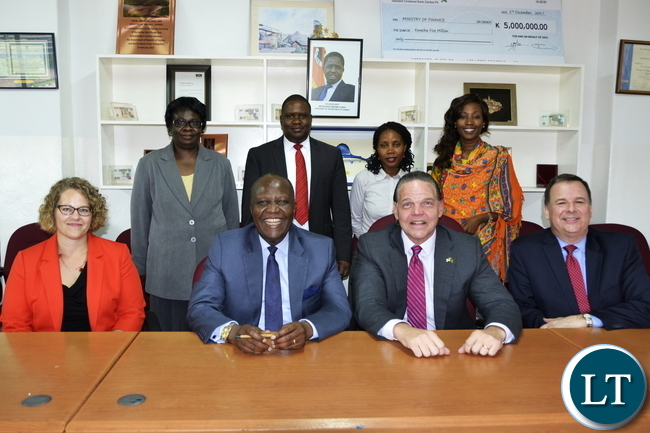 United States Ambassador To Zambia Daniel Foote with staff at Ministry of Finance