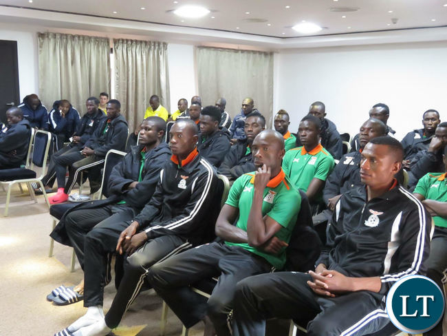 National team players listening to Sports minister Moses Mawere shaking