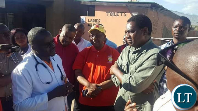 Mr Hichilema and top UPND officials receiving a brief from a Ministry of Health official during the tour of the Cholera centers.